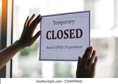 Closed businesses for COVID-19 pandemic outbreak, closure sign on retail store window banner background. Government shutdown of restaurants, shopping stores, non essential services. - Shutterstock ID 1764599645