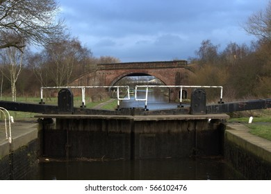 A closed canal lock at a canal in Wakefield on a cloudy dull day