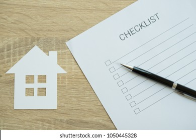 Closed up of checklist with house inspection - to do list