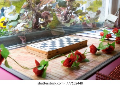 A Closed Chess Board Waits For Intelligent Grandmaster In A Picturesque  Garden