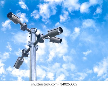 Closed circuit camera on sky background with clipping path