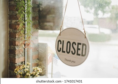 Closed. coffee cafe shop text on vintage sign board hanging on glass door in modern cafe coffee shop, cafe restaurant, retail store, small business owner, takeaway food, food and drink concept