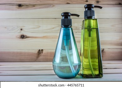 Closed Cosmetic Or Hygiene Plastic Bottle Of Gel, Liquid Soap, Lotion, Cream, Shampoo.  On Wood Background.