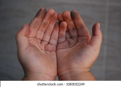 Closed up toddler's dirty hands after playing in the playground.