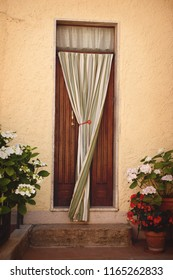Closed door with curtain in Tuscany, Italy