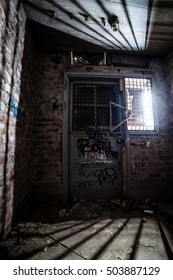 Closed door at dirty abandoned factory