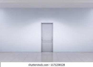 Closed door white building interior walls in clan hallway