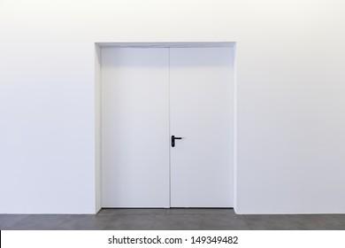 Closed door white building interior walls, construction