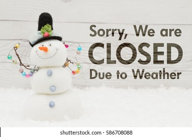 Closed due to weather message, A snowman with text Closed due to weather on weathered wood