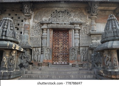 Closed entrance to the ancient Indian temple. The massive wooden door is locked.