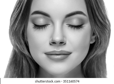 Closed eyes Beautiful woman face close up portrait young studio black and white