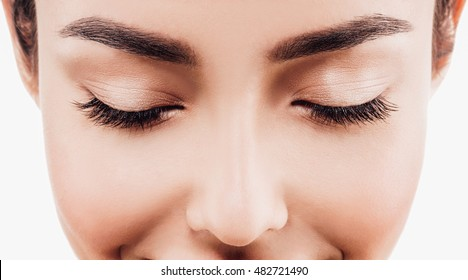 Closed eyes lashes closeup. Beauty Spa Woman with perfect healthy face skin Portrait. Beautiful model Spa Girl isolated on white