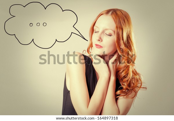 closed eyes portrait of a young girl with red hair with speech  bubble
