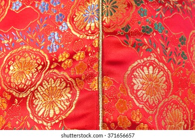 "Closed up Fabric of Traditional Chinese Red knot buttons made from silk ""Chinese Qipao"" with beautiful patterns"