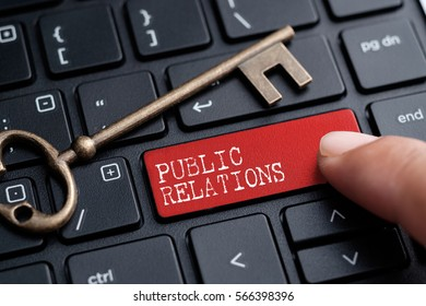 Closed up finger on keyboard with word PUBLIC RELATIONS