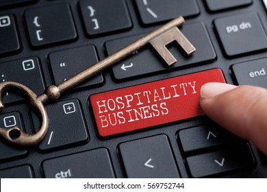Closed up finger on keyboard with word HOSPITALITY BUSINESS