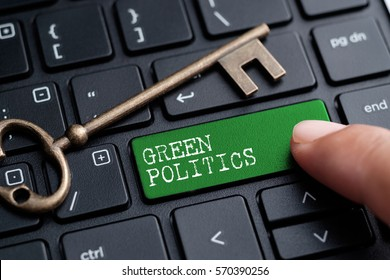 Closed up finger on keyboard with word GREEN POLITICS