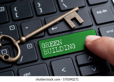 Closed up finger on keyboard with word GREEN BUILDING