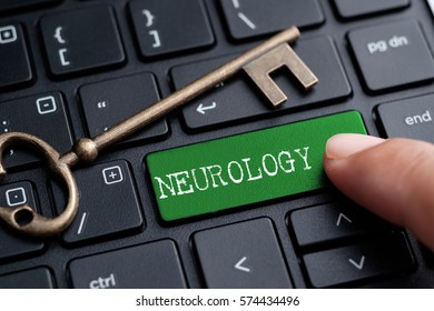 Closed up finger on keyboard with word NEUROLOGY