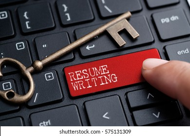 Closed up finger on keyboard with word RESUME WRITING