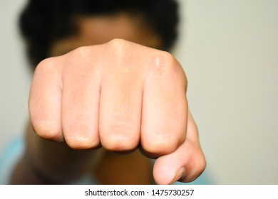 Closed fist hand of girl