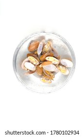 Closed up fresh baby clams, venus shell, shellfish, carpet clams, short necked clams, as raw food from the sea are the seafood ingredients. fresh clams Background.