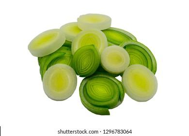 closed up fresh sliced green leeks over white background
