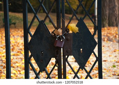 Closed gate to town park during autumn fall