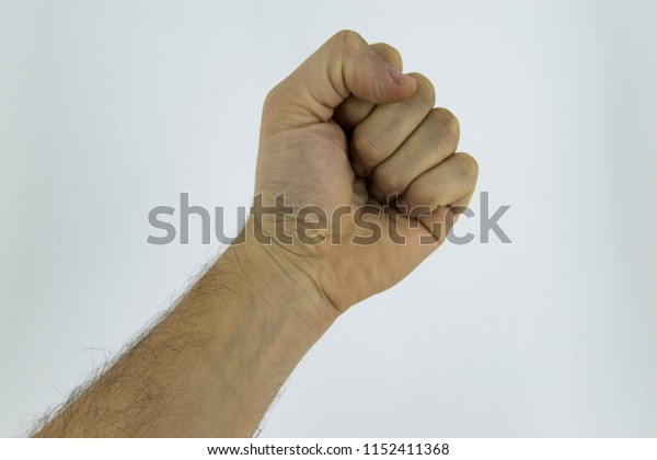 Closed hand against a white background