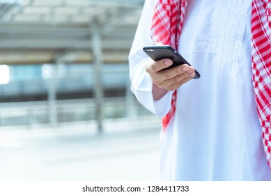 Closed up of hand Young businessman Arabian entrepreneur talking on mobile phone cell phone for good deal successful .Arab man surfing internet for social media on smartphone outdoor in the city.