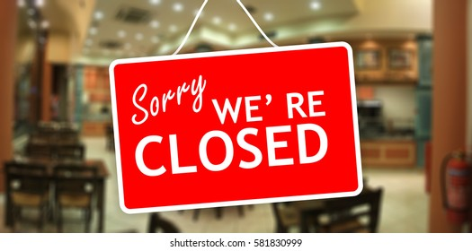 Closed for holiday. Sorry we are closed red tag hanging on a glass storefront