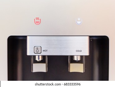 closed up of hot and cold faucet of water dispenser, water cooler