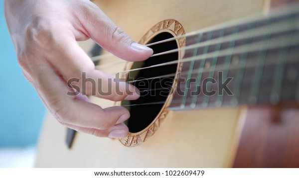Closed Human Hand Playing Guitar Picture Stock Photo (Edit