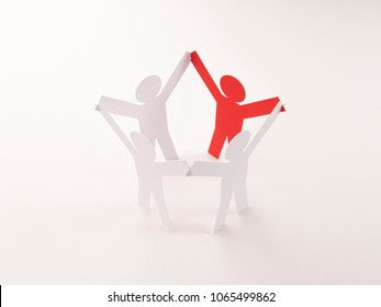 closed joining of four paper figure with red one in hand up posture on bright white background. in concept of business and leadership. selective focused point