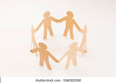 closed joining of six  brown paper figure in hand down posture on bright white background. in concept of business, cooperation and teamwork