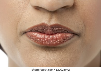 Closed lips of an Indian woman