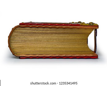 Closed and locked red leather book with gilded paper edges captured isolated and from the bottom side while lay down to the table.
