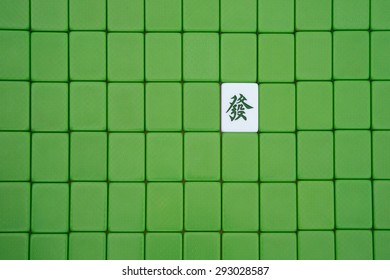 closed mah jong bricks with one opened