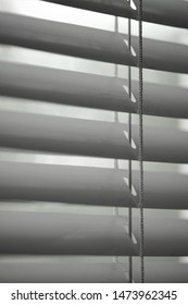 Closed metal shutters and rope closeup. Background blinds. Black and white photo jalousie