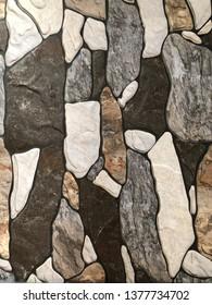Closed up of natural (white, brown, black) stone tile texture for decorative outside wall or floor