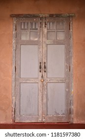Closed old typical vintage and grunge wooden door.