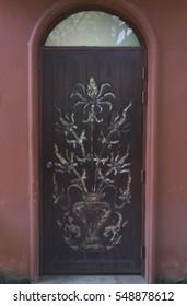 closed old wood door, gate, doorway and orange wall