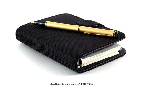 The closed pad and the pen on a white background. Isolated.