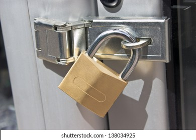 Closed padlock on  a metal door