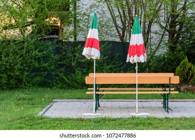Closed parasols with the national colors of Italy