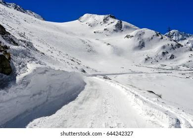 Closed pass road in winter, Great St Bernard Pass, Bourg-Saint-Pierre, Valais, Switzerland