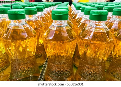 Closed up pile of bottled palm oil in the market