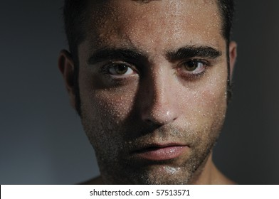 Closed portrait of a man with water drops