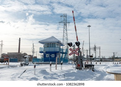 Closed railway crossing. Somewhere in the winter in Russia.