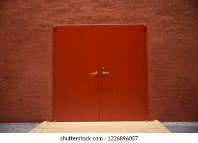 Closed red door isolated on background